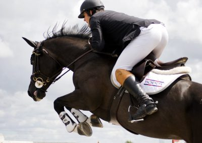 black_horse_jumping_by_equinelovex-d3agd2b